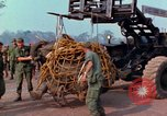 Image of Elephant airlifted Vietnam, 1968, second 3 stock footage video 65675067651