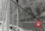 Image of Tourists leave ship by motorboat to visit Vargas Venezuela, 1936, second 10 stock footage video 65675067694