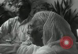 Image of people worship India, 1961, second 7 stock footage video 65675067726