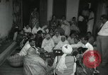 Image of people worship India, 1961, second 9 stock footage video 65675067726