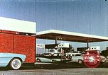 Image of gas station Philadelphia Pennsylvania USA, 1958, second 10 stock footage video 65675067782