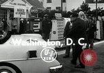 Image of Vice President Richard Nixon pumps gas for March of Dimes Washington DC USA, 1955, second 5 stock footage video 65675067831