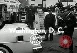 Image of Vice President Richard Nixon pumps gas for March of Dimes Washington DC USA, 1955, second 6 stock footage video 65675067831