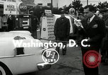 Image of Vice President Richard Nixon pumps gas for March of Dimes Washington DC USA, 1955, second 7 stock footage video 65675067831