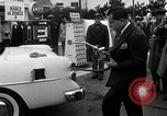 Image of Vice President Richard Nixon pumps gas for March of Dimes Washington DC USA, 1955, second 8 stock footage video 65675067831