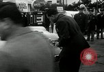 Image of Vice President Richard Nixon pumps gas for March of Dimes Washington DC USA, 1955, second 9 stock footage video 65675067831