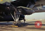 Image of Airman performs visual inspection of AC-119K Stinger aircraft Ohio USA, 1969, second 12 stock footage video 65675067912
