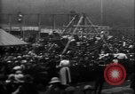 Image of a large outdoor fair United Kingdom, 1915, second 8 stock footage video 65675067969