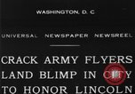 Image of Army aviators land blimp at Lincoln Memorial Washington DC, 1930, second 1 stock footage video 65675068048