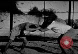 Image of Recruits wrestling at an Indian Army camp India, 1938, second 1 stock footage video 65675068241