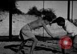 Image of Recruits wrestling at an Indian Army camp India, 1938, second 2 stock footage video 65675068241