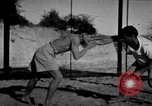 Image of Recruits wrestling at an Indian Army camp India, 1938, second 3 stock footage video 65675068241