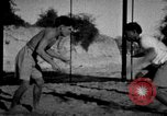 Image of Recruits wrestling at an Indian Army camp India, 1938, second 4 stock footage video 65675068241