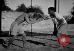 Image of Recruits wrestling at an Indian Army camp India, 1938, second 5 stock footage video 65675068241