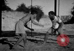 Image of Recruits wrestling at an Indian Army camp India, 1938, second 6 stock footage video 65675068241