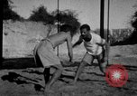 Image of Recruits wrestling at an Indian Army camp India, 1938, second 7 stock footage video 65675068241