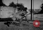Image of Recruits wrestling at an Indian Army camp India, 1938, second 8 stock footage video 65675068241
