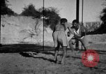 Image of Recruits wrestling at an Indian Army camp India, 1938, second 9 stock footage video 65675068241