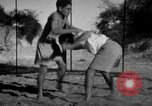 Image of Recruits wrestling at an Indian Army camp India, 1938, second 12 stock footage video 65675068241