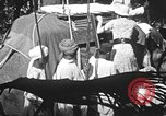 Image of elephant ride India, 1938, second 2 stock footage video 65675068242