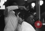 Image of barber Harlem New York City USA, 1930, second 10 stock footage video 65675068244
