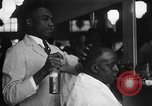 Image of barber Harlem New York City USA, 1930, second 12 stock footage video 65675068244