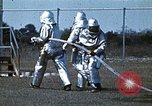 Image of fire fighting drill United States USA, 1971, second 11 stock footage video 65675068264