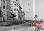 Image of buildings and market Singapore, 1946, second 7 stock footage video 65675068276