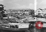 Image of buildings and market Singapore, 1946, second 12 stock footage video 65675068276