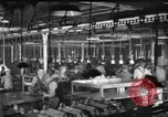 Image of automobile assembly line United States USA, 1929, second 2 stock footage video 65675068386