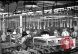 Image of automobile assembly line United States USA, 1929, second 5 stock footage video 65675068386