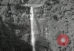 Image of activities near waterfall United States USA, 1916, second 3 stock footage video 65675068418