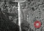 Image of activities near waterfall United States USA, 1916, second 4 stock footage video 65675068418