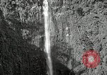Image of activities near waterfall United States USA, 1916, second 6 stock footage video 65675068418