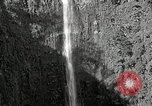 Image of activities near waterfall United States USA, 1916, second 8 stock footage video 65675068418