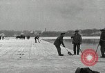 Image of Cutting ice blocks from a frozen lake United States USA, 1916, second 1 stock footage video 65675068419