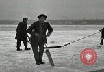 Image of Cutting ice blocks from a frozen lake United States USA, 1916, second 6 stock footage video 65675068419