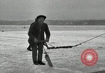 Image of Cutting ice blocks from a frozen lake United States USA, 1916, second 7 stock footage video 65675068419