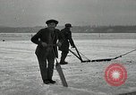 Image of Cutting ice blocks from a frozen lake United States USA, 1916, second 8 stock footage video 65675068419