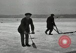 Image of Cutting ice blocks from a frozen lake United States USA, 1916, second 9 stock footage video 65675068419