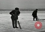 Image of Cutting ice blocks from a frozen lake United States USA, 1916, second 10 stock footage video 65675068419