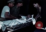 Image of wounded troops Pacific Theater, 1945, second 11 stock footage video 65675068438