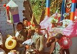 Image of masked mummers Guatemala, 1946, second 4 stock footage video 65675068497