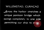Image of passenger steamship arrival Willemstad Curacao, 1936, second 2 stock footage video 65675068691