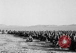 Image of US soldiers witness atomic explosion Camp Desert Rock Nevada USA, 1951, second 11 stock footage video 65675068697