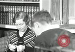 Image of American family listening to their radio United States USA, 1935, second 6 stock footage video 65675068707