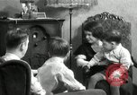 Image of Family listening to their radio Chicago Illinois United States USA, 1935, second 2 stock footage video 65675068708