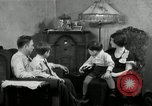 Image of Family listening to their radio Chicago Illinois United States USA, 1935, second 7 stock footage video 65675068708