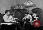 Image of Family listening to their radio Chicago Illinois United States USA, 1935, second 9 stock footage video 65675068708