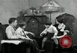 Image of Family listening to their radio Chicago Illinois United States USA, 1935, second 10 stock footage video 65675068708